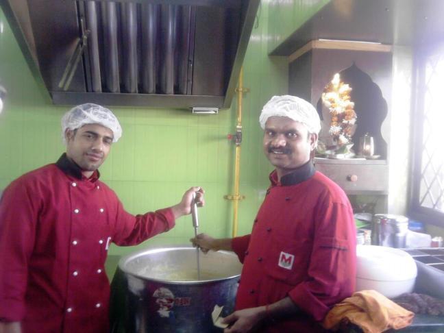 Chefs of Madhuban preparing food.