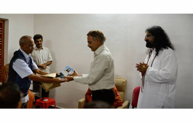 Dr.Raman releasing the first copy to Dr.Padmanabhan