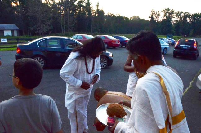 2 M was invited to the Sai Temple for a discourse (satsang) and to do Baba's aarti...
