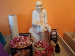 Offering flowers at Shirdhi Baba's feet