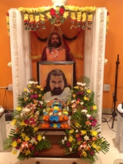 MohanJis birthday alter. The four lovely bouquets was offered by Simeel