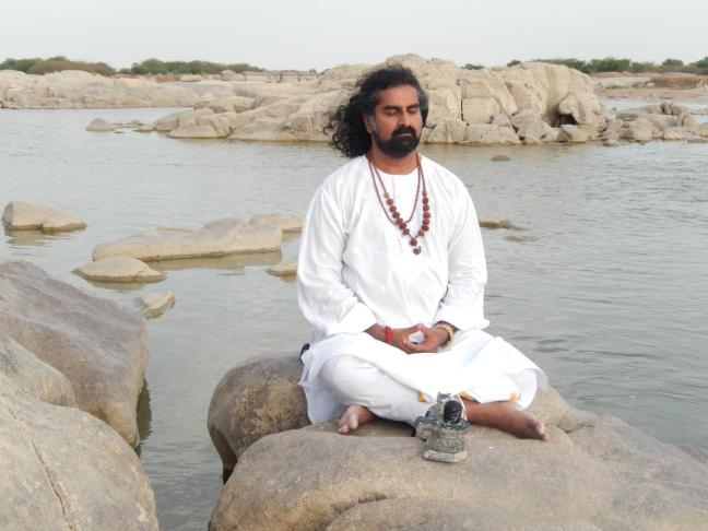 Mohanji in communion with the Almighty at the Krishna river.