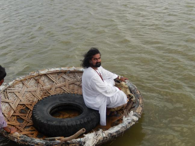 Ferrying on the boat to cross Krishna river to reach the temple on the other bank of the river.