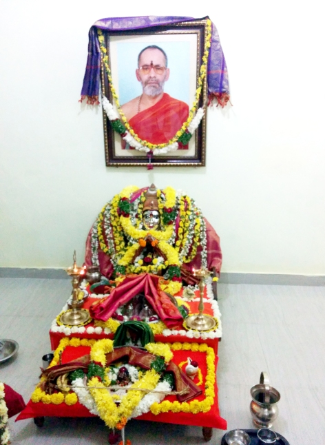 Divine Mother and the photo of Swamy Thyagananda's Guru