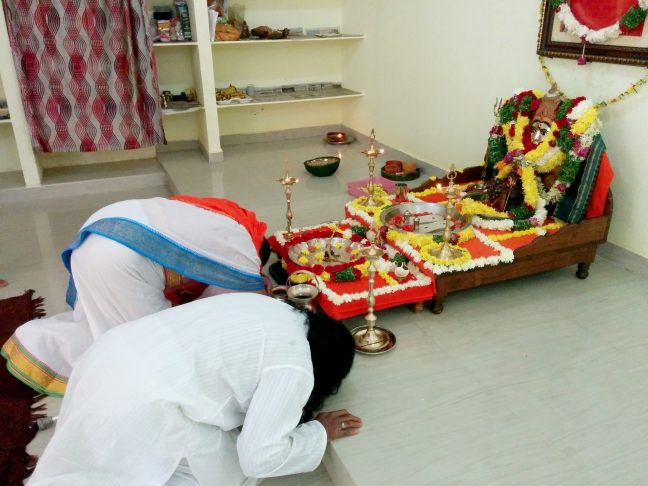 Masters bowing to the Divine Mother