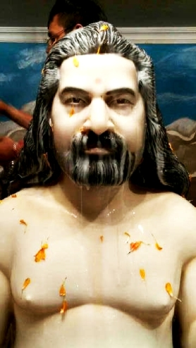 Babaji being bath with almond milk