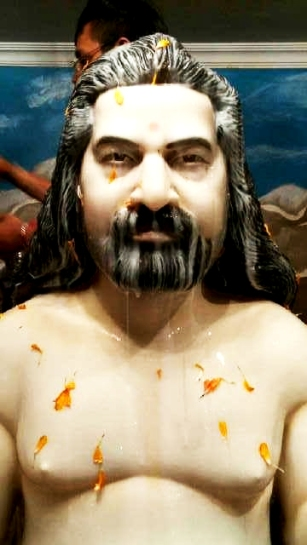 Babaji being bath with almond milk