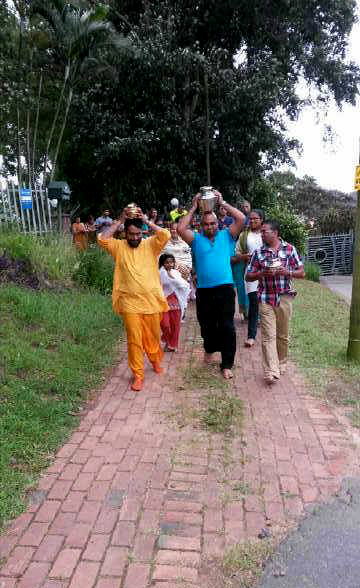 Holding the milk and Rose water as we chanted Mohanjis glories and walked