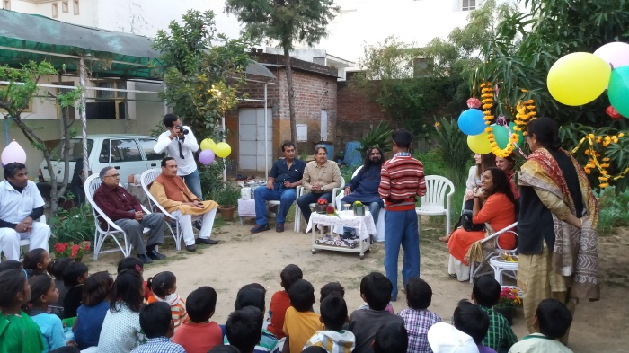 Karan a child wecoming and wishing Mohan ji on behalf of childrens