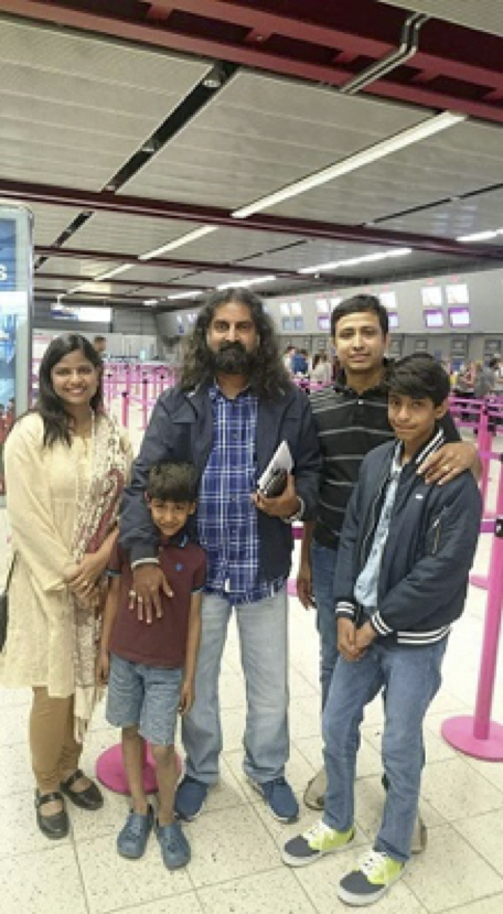Mohanji with Subhashree Family at the Airport.jpg