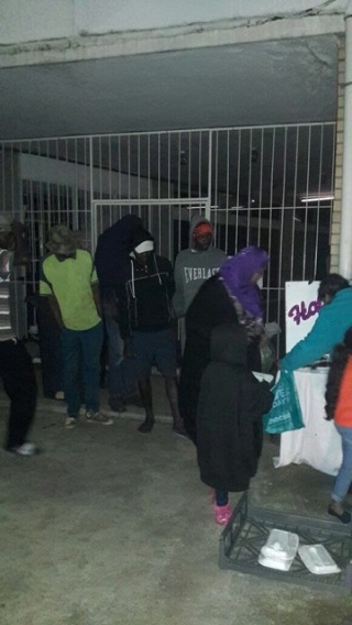 Food served on a cold rainy night to the ones in need and cake was served as well (2)