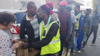 Lunch served in poor part of Johannesburg and food packet distributed (2)