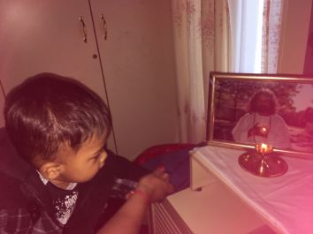 Ariv doing aarti with my mum