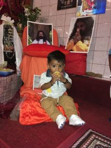 Choosing to eat a fruit prasad while sitting on Mohanji's foot cushion
