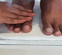 Taking Mohanji's foot print on clay