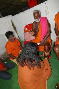 A Royal Vision_Mohanji Pressing leg of Shiva bhakta