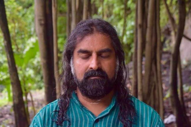 Mohanji eyes closed